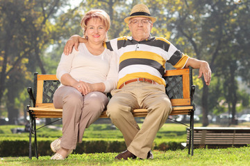 Mature couple relaxing in a park on sunny day