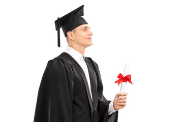 Proud college graduate holding a diploma