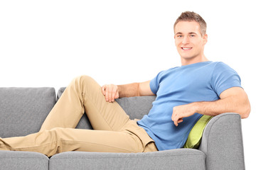 Relaxed young man sitting on a sofa