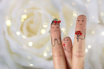 Conceptual family finger art. Father and son is giving flowers