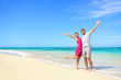 Freedom on beach vacation - happy carefree couple
