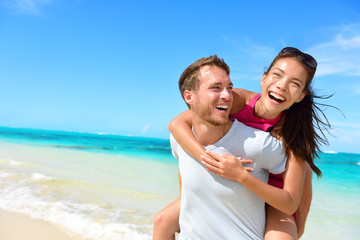 Happy couple in love on beach summer vacations