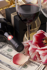 Wine. money, gift and tulips