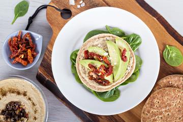 Vegan sandwich with hummus, avocado and tomatoes