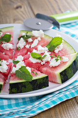 Watermelon pizza with feta cheese and herbs