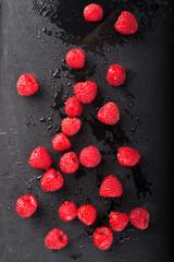 Raspberries on Black Slate