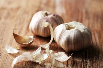 Raw garlic on wooden table