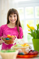 girl holding colorful eggs
