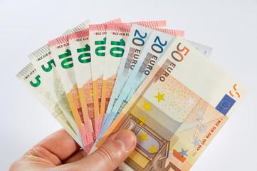 Geldfächer in der Hand