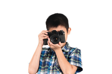 handsome boy with an old camera isolated on white.