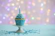 Leinwandbild Motiv Delicious cupcake on table on light background