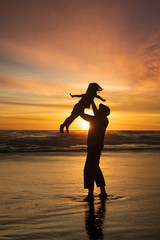 Girl enjoy holiday with father at beach
