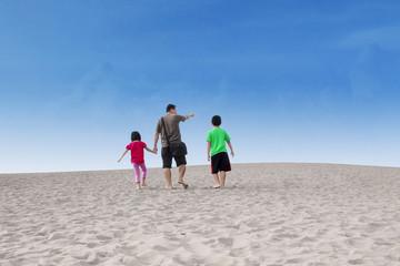 Happy family walk on desert