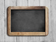 Leinwanddruck Bild - old chalkboard or blackboard on white wood