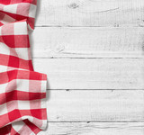 red folded tablecloth over white wooden table - 79817140