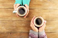 """Постер, картина, фотообои """"Female hands holding cups of coffee"""""""