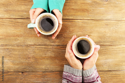 Fotobehang Koffie Female hands holding cups of coffee