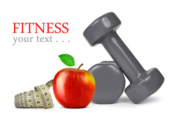 Fitness dumbbells with apple and measuring tape