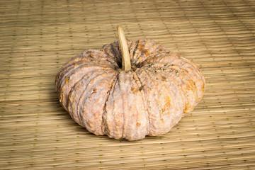 pumpkin still life on mat weave