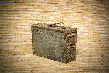 old ammunition box still life mat weave background