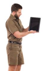 Man in khaki uniform showing a shockproof digital tablet.