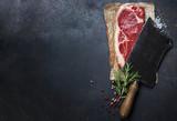 Fototapety vintage cleaver and raw beef steak