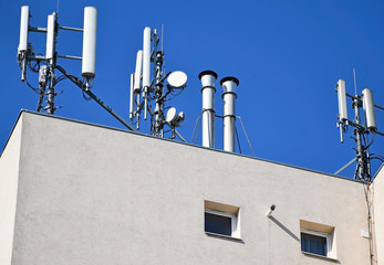 Antennas on the roof of a high building