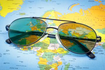 Pilot sunglasses on a world map