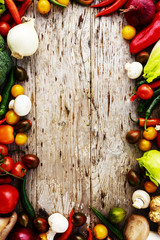 Frame of various vegetables over a wooden background with