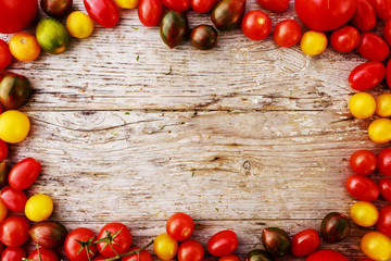 Frame of tomatoes on wooden background