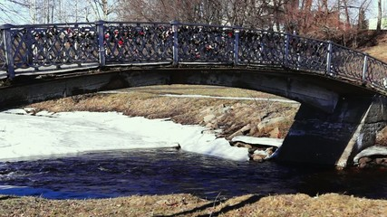 Park river footbridge in spring