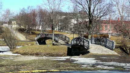 Two bridges in city in spring