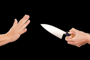 woman hand holding knife pointed at a man