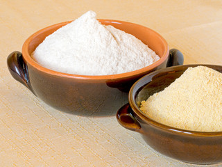 Wheat and maize flour in bowls. Unbleached, stone ground.