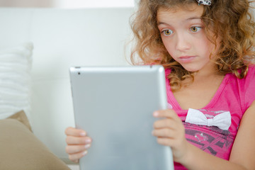 Little girl using a tablet computer