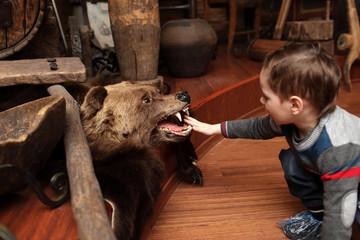 Child and stuffed bear