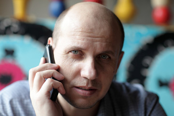 Serious man with mobile phone