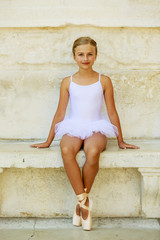 Ballet-dancer in white dress and pointe shoes