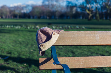 Abandoned hat on a bench