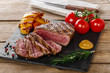 grilled beef steak rare sliced with vegetables - 79833324
