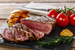 grilled beef steak rare sliced with vegetables - 79833732
