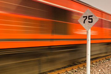 Limit speed sign and moving train