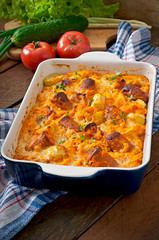 Casserole with sausage, bacon and apples in a pumpkin sauce