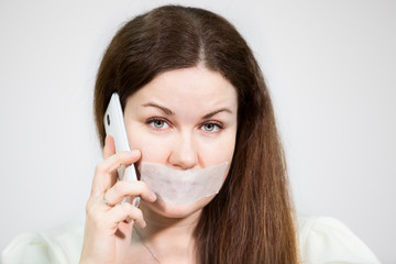 Caucasian woman with sad eyes and mouth sealed call mobile