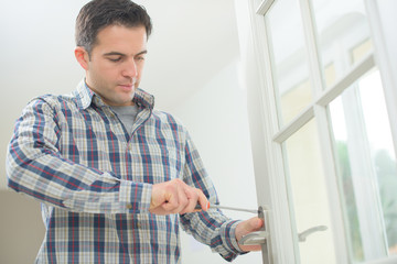 Handyman fitting a new door