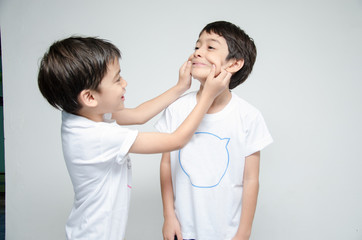 Little asian sibling boy playing together teasing