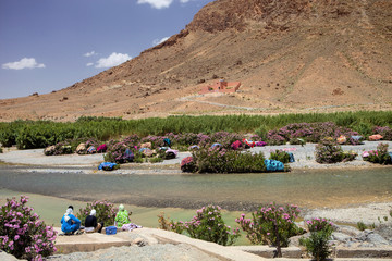 Drying Carpet laundered by the river in Morocco