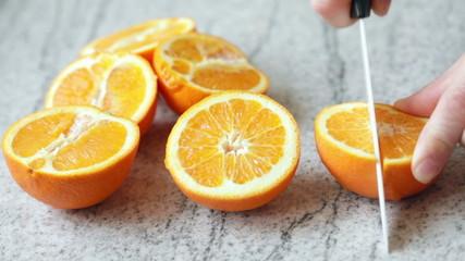 Cutting fresh orange