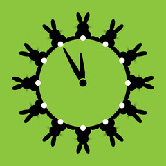 twelve black bunnies with white tails as wall clocks