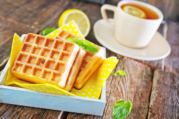 tea with lemon and waffle